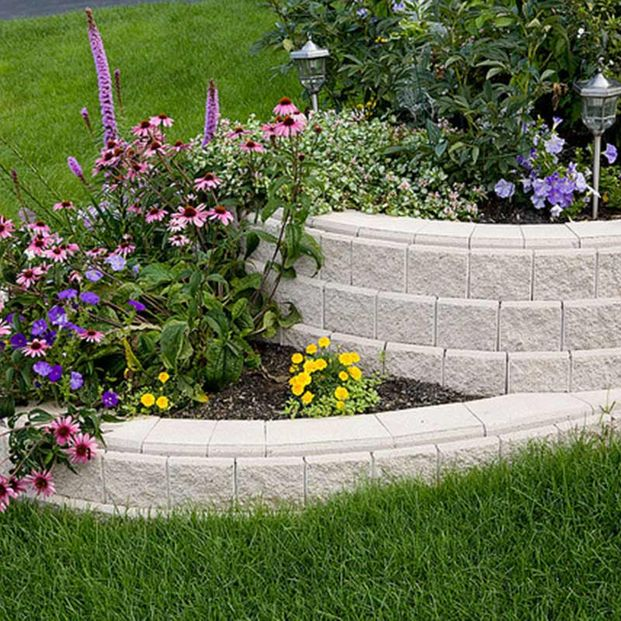 Flower bed with retaining wall